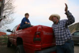 DLM0810  Jerrin Vaught, 11, left, sits in the back of his of Gene Stapp's pick-up outside the Red...