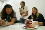 DLM6993  Euclid Middle School student Megan Reetz, 12, center, cringes as she and her classmate...
