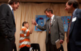 (DENVER, Colo., May 18, 2004) Mayor John Hickenlooper, center, gives Cheltenham Elementary student...