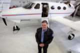Rick Adam (cq) founder of Adam Aircraft, stands next to the Adam Aircraft's  A-500 aircraft at...