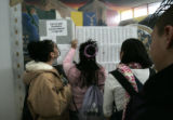 Students at Montbello High School in far northeast Denver check a CSAP location posting March 1,...