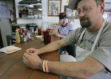 Owner Chip Thomas (cq) recalls Emily Keyes and behind him is head waitress Maryann Hewitt at the...
