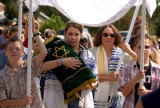 (CENTENNIAL Colo., August 22,2004)  Lisa Jacobson, 16 years old, takes a turn carrying the Torah...