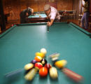 "22 year-old Patrick Callahan (cq) ""breaks"" at Tarantula's Billiards in Denver, Colorado..."