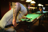 22 year-old Patrick Callahan (cq) shoots a game of pool at Tarantula's Billiards in Denver,...