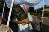 (CENTENNIAL Colo., August 22,2004)  Bill Lookner, 69 years old, takes a turn carrying the Torah of...