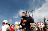 (Centennial, Colo., August 19, 2004) (Center) Bagpiper Scott Beach,  played his pipes after the...