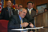 Governor Bill Ritter signs SB 87, Wednesday afternoon, April 11, 2007, at the Capital, in Denver....
