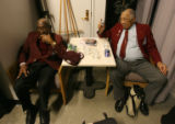 Tuskegee Airman Retired Maj. Jim Harrison (cq), right, takes a photo of Retired Lt. Col. John...