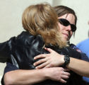 L to R: Tonya Fisk (cq) gives a hug to Aurora Police Officer Cassidee Carlson (cq) after  a public...