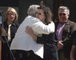 L to R: Rosa Bunn (cq), of White Birds Unlimited, hugs Lisa Parks after releasing a white dove...
