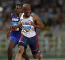 (Athens, Greece  on Sunday, Aug. 22, 2004) -  American sprinter Maurice Greene glances at teammate...