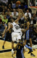 Denver Nuggets' #23, Marcus Camby, right, blocks a shot by San Antonio Spurs' #21, Tim Duncan,...