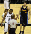 San Antonio Spurs' #5, Robert Horry, left, complains to the referee, about Denver Nuggets' #21,...