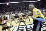 Denver Nuggets forward Carmelo Anthony walks off the court with a sneer after being defeated by...