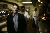 0040 Denver City Council candidate for district 3, Paul Lopez, CQ, stands in the kitchen at the...
