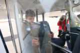 Julian Willis, (cq), 10, has fun impersonating a pilot while waiting for Sue Ivison to take the...