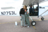 Julian Willis, (cq), 10, gets a happy hug from his mom, JoAnne Willis as pilot Sue Ivison brought...