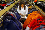 (Denver, Colo., August 31, 2004) Michelle Johnson, a temp worker in the apparel section for the...
