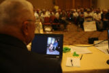 Radiation Board member Robert Presley (cq) looks at family photographs while the meeting in which...