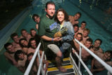 (at center) 44 year-old Howard Lunger (cq) and his wife, 43 year-old Susy Lunger (cq) pose for a...