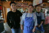 Three generations of Lams Patrick Lam, 15 , Billy Lam and Khai Lam, 80 all work in the Chef's...