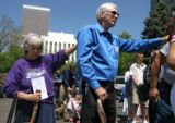 Judy Ford (cq), left and Frank Mastroni (cq) touch shoulders  during prayer at the National Day of...