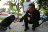 DLM0317  Denver City Council candidate Chris Nevitt, right, is greeted by Patti Drake's dog,...