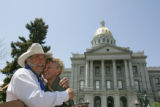 State Rep. Wes McKinley hugs his wife Jan McKinley before Governor Bill Ritter signs House Bill...