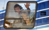 (Denver, Colo., August 31, 2004) Father Markus Georg, left, and his son, Johannes Georg, 8, wave...