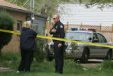 JOE010 Mary Brunkow (cq), left, talks to a police offficer investigating on Monday morning, May 7,...