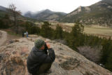 MJM023 Matt Propert (cq), 24, of Gold Hill, Colorado uses a pair of binoculars to look for ram and...