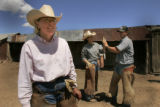 Kimmi Lewis ranch owner looks over the remaining calves to be branded as her daughter Kerry Lewis...