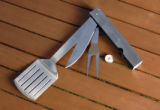 Spotlight food:  Grilling tools - Story about high-end picnics: Today, dining al fresco might mean...