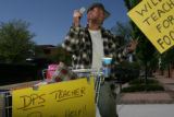 Carsten Engebretsen, (cq) reacts after receiving a $1 donation outside the Denver Public Schools...