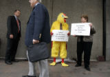 Qwest spokesperson Bob Toevs (cq), left, stands out in front of Denver's Grand Hyatt Hotel while...
