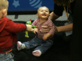 Ashlynn Davis, nine months, from Broomfield, gives her mom Erica Davis (cq), a big smile, while...