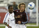 CODZ104 - Real Salt Lake forward Atiba Harris, left, battles for the ball with Colorado Rapids...