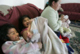0319 Marleny Navaro, CQ, 30, right, of Guatemala, holds her daughter Adelpha, 2mo. while her niece...