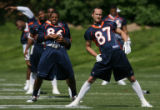 MJM028 Broncos wide receivers, Brian Clark, left, stretches along with David Kircus, right, during...