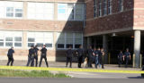 Boulder Police and SWAT team members prepare to enter Boulder High School Thursday May 10,2007. A...