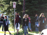 Boulder High School students wait east of the school as Boulder Police and SWAT team members ...