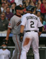 Rockies Troy Tulowitzki, left, and Giants pitcher Noah Lowry, bump into each other after...