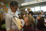 7 year-old Angela Dean (cq) talks to first grade teacher Nancy Peterson (cq), after a book review...