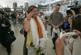 Kirsten Westby of Boulder, Colo., wipes tears away from her eyes as she is welcomed by Tibetans...