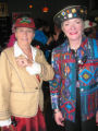 Lise Gresock, left, wears a Christmas baseball cap beloved by Denzer and Pam Larsen wears one of...