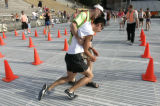0577  Runner Matt Provencio, CQ, of Aurora, 20, is helped by a volunteer after he colapsed at the...