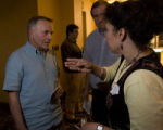 Mary Arenas of Cedar Rapids (right) confronts U.S. Congressman Tom Tancredo about his use of the...
