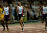 (ATHENS, GREECE-AUGUST 23, 2004) United States' Jeremy Wariner, center, Otis Harris, second from...
