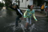Friends, Jamica Zion, (cq)14 and Ophelia Pulsinelli (cq) 12 practise their curb jumping with...